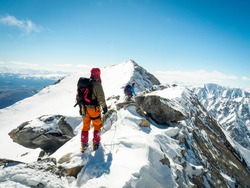 Climber in the mountains winter