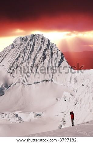Climber looking on Alpamayo peak - stock photo