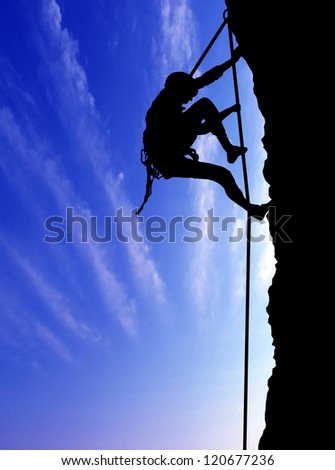 climber on blue sky background.