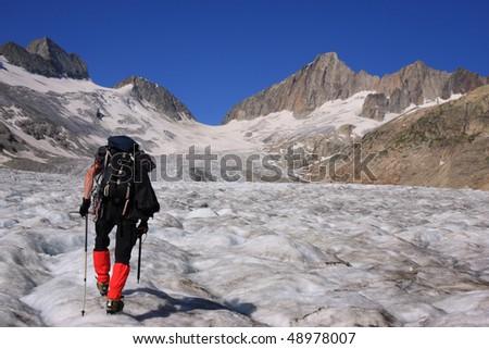 stock-photo-climber-on-glacier-of-the-oberaarhorn-berner-oberland-switzerland-48978007.jpg