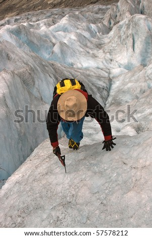 Climber on ice of glacier.Norwegian glacier.Nigardsbreen glacier.