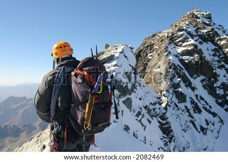 Climber on sharp mountain ridge