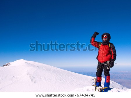 Climber on snowy summit