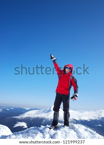 Climber on the peak of mountain. Sport and active life