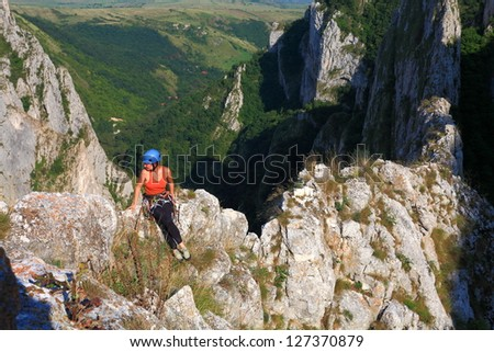Climber on the rock , high above ground