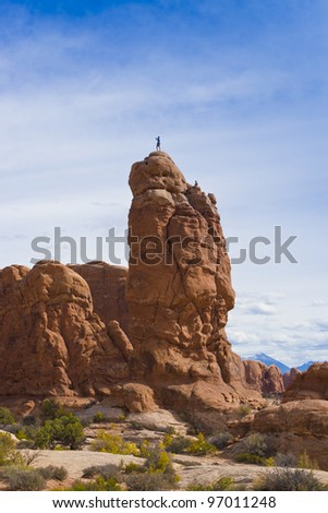 Climber on the Rock in Arches National Park. Utah, USA