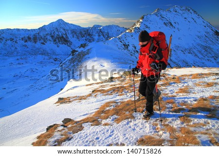 Climber on the snowy mountain during winter, Romania #140715826