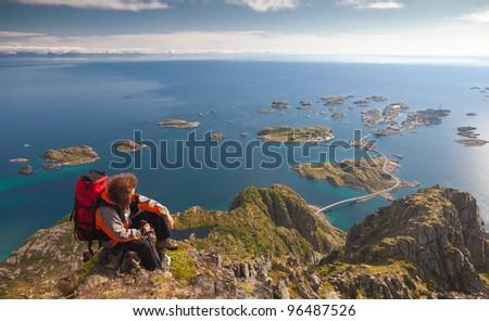 climber on top of rock near ocean