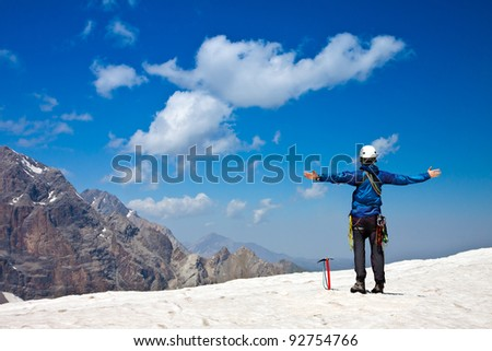 Climber on top of snow summit