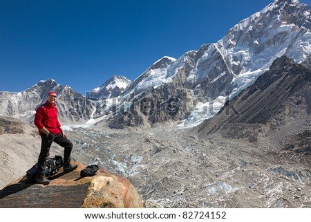 Climber overlooking the Khumbu glacier on the way to Everest base camp.