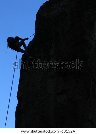 climber rappelling off the Fifth Flatiron in Boulder, CO