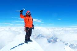 Climber  reaches the summit of Everest. Mountain peak Everest. Highest mountain in the world. National Park, Nepal