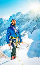 Climber reaching the summit, Nepal Himalayas