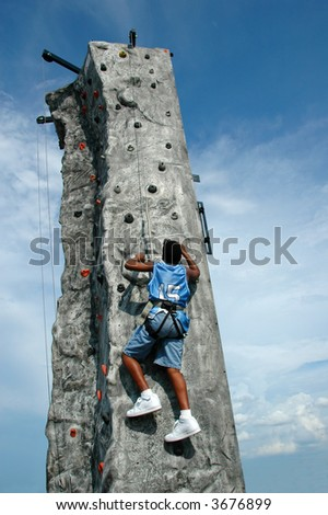 Climber reaching the top