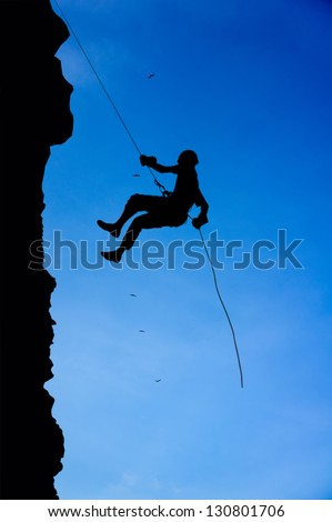 climber silhouette on blue sky background