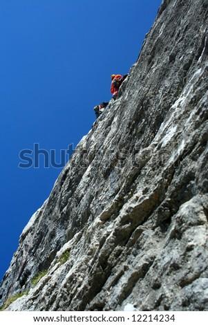Climber team climbing on rock