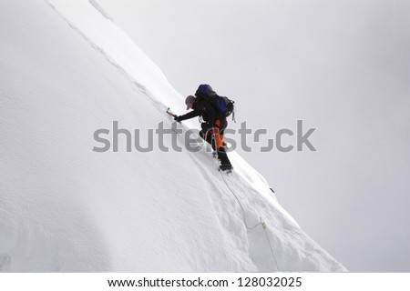 climber the summit of island peak, nepal. - stock photo