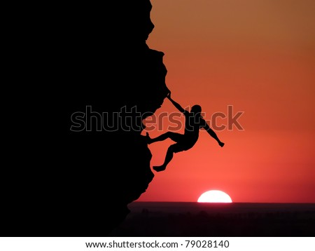 climber to conquer the peak - stock photo