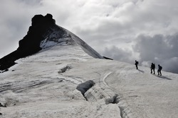Climbers approaching to summit of Snaefellsjokull volcano at 1446 meter height, West Iceland.
