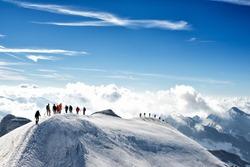 climbers climbing the mountain with mountain equipment, high mountain activity
