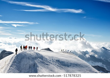 climbers climbing the mountain with mountain equipment, high mountain activity #517878325