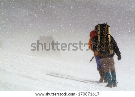 Climbers going for the top in a snow storm.Copy space