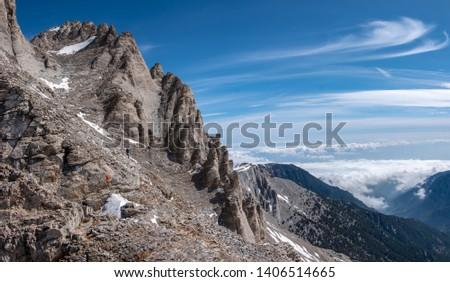 Climbers on the trail from Scala summit to Mytikas summit, the highest mountain of Olympus ridge in Greece. Climbing Mytikas summit. #1406514665