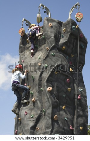 climbers reaching the top