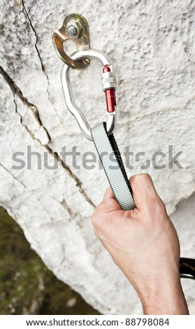 Climbing carabiner on rock wall