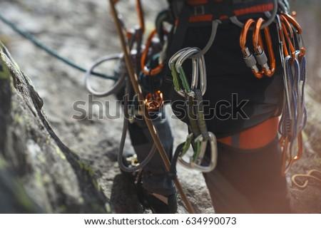 Climbing gear and equipment closeup. Tilt-Shift effect. #634990073