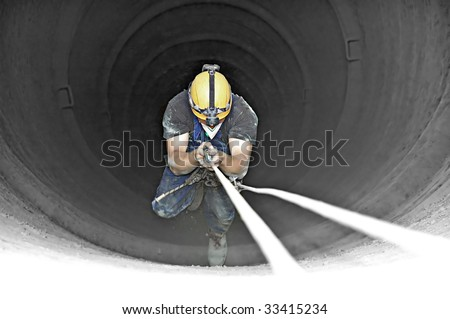 Climbing industrial worker in the H-150m 3m wide chimney