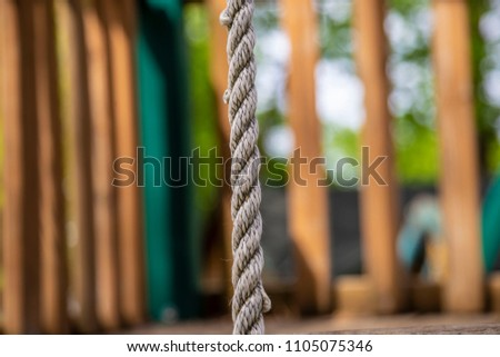 Climbing rope jungle gym playground close up macro twisted white woods climbing achievement climb rappel