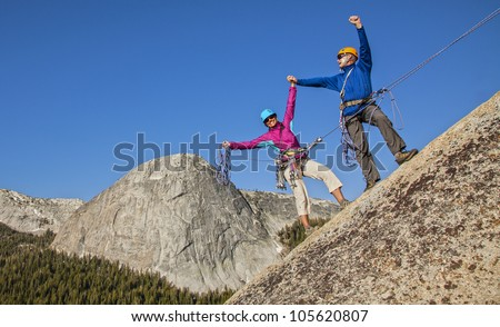 Climbing team on the summit celebrate  after a challenging ascent.