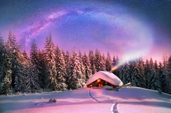 Climbing to tourist wild alpine mountain to an abandoned cabin-in order to illuminate the snow-covered spruce canopy. Christmas in the Carpathians.In the frosty sky from overheated stove sparks of ...