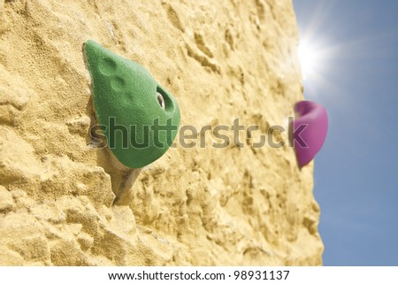 Climbing wall with artificial handles