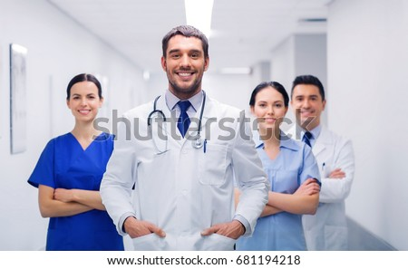 clinic, profession, people, health care and medicine concept - happy group of medics or doctors at hospital corridor #681194218