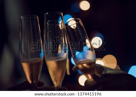 Clink Glasses for celebration or party with blurry photo #1374415196