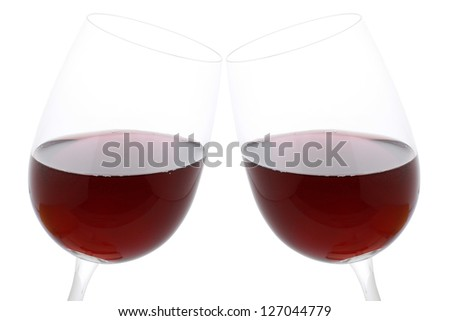 Clink glasses with red wine, isolated on a white background