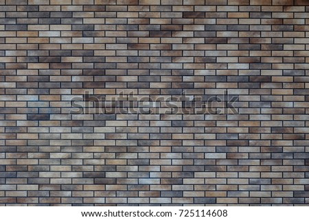 Clinker brick. Brickwork. Dark colored clinker brick. Texture.