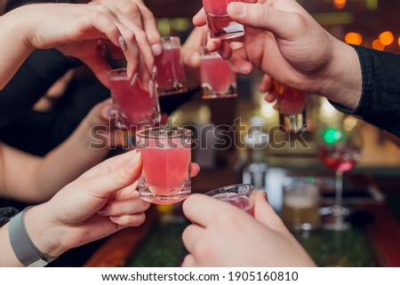 Clinking glasses with alcohol and toasting, party. Сток-фото ©