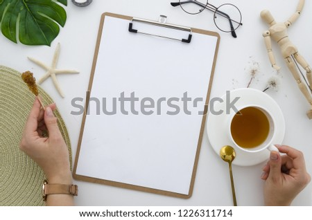 Clipboard mockup flatlay. Creative girl drinking tea, top view of the artist creativity creativity
