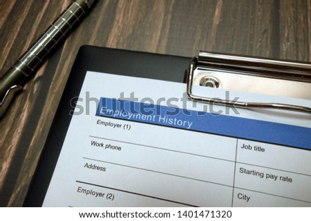Clipboard with employment history document, job application form