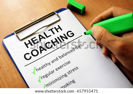 Clipboard with health coaching list. Healthy living concept.