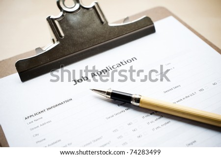 clipboard with job application and pen