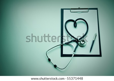 clipboard with stethoscope and pen