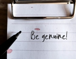 Clipped note and pen with text written BE GENUINE , self reminder to be yourself , truly what something authentic , be real and what it appears to be