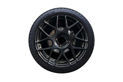 Clipping path. Black Wheel super car isolated on white background view. Magneto wheels. Movement. Wheel super car.