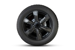 Clipping path. Black Wheel super car isolated on White background view. Movement. Magneto wheels.