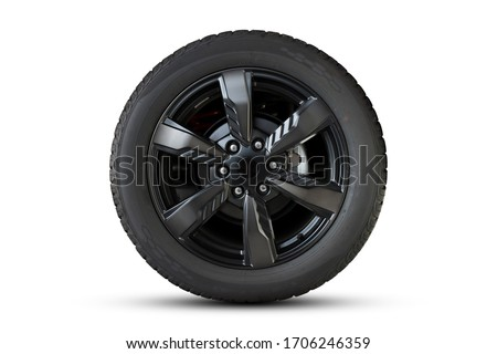 Photo of  Clipping path. Black Wheel super car isolated on White background view. Movement. Magneto wheels.