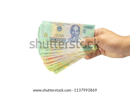 clipping path Money in Vietnam on hand (Socialist Republic Of Vietnam), Dong, VND, Pay, exchange money isolated on white background.